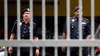 Senior Malaysian police personnel walk outside the Forensic wing at the Hospital Kuala Lumpur on February 15, 2017