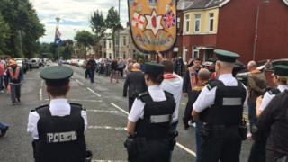 Members of the three lodges involved in the Ardoyne parade dispute arrived at police lines led by the Ballysillan banner on Saturday