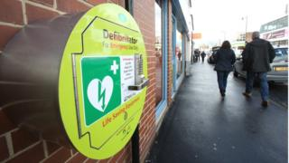 An emergency defibrillator on a wall in the centre of Garforth, Leeds.
