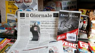 "Il Giornale newspaper is seen on sale in a newsstand with Hitler's ""Mein Kampf"", in Rome Saturday, June 11, 2016."