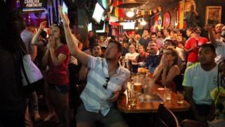 US fans gesticulate during the match