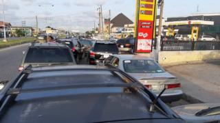 Long queue of cars for petrol filling stations