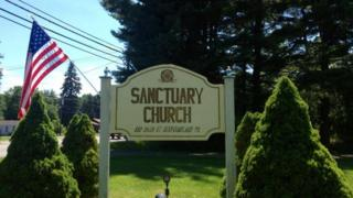 Sign outside church with American flag