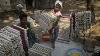 A Bangladeshi child works at balloon factory in Dhaka on October 20, 2014