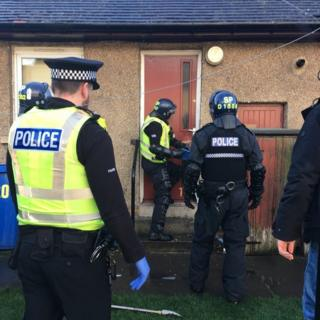 Police officers on raid