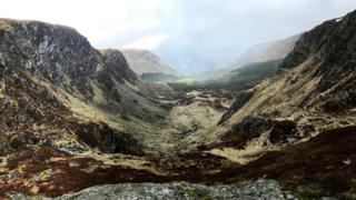A turn in the weather meant a moody backdrop from the plateau above Corrie Fee in Angus, says Laura Fleming. She was out on a run to explore the glacier-carved landscape.