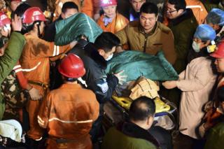 "In this 25 December 2015 photo released by China""s Xinhua News Agency, a trapped miner is rescued from a collapsed gypsum mine in Pingyi County, east China""s Shandong Province."