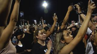 Mourners attend a vigil in El Paso