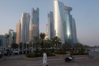 A man walks on the corniche in Doha, Qatar, 15 June