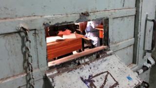 A classroom behind a locked door