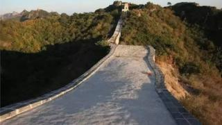 A long, cement-like path tops the stretch of the Great Wall after repairs