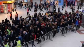 Queues for the Gatwick Express at London Victoria