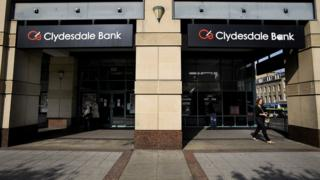 People walk past a branch of Clydesdale Bank in Edinburgh