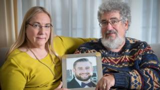 Mary Rich and her husband, Joel Rich hold a photo of their son, Seth Rich, who was murdered in Washington
