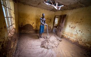 Abdul Mansaray cleaning his house