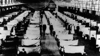 A warehouse being used as a makeshift hospital for flu patients in 1918