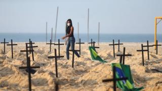 "A Rio de Paz member helps create the ""monument"" on Copacabana"