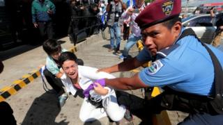 """Riot police detain a protester during a march called """"United for freedom"""" against Nicaraguan President Daniel Ortega in Managua"""
