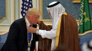 President Donald Trump receives the Order of Abdulaziz al-Saud medal from Saudi Arabia's King Salman bin Abdulaziz al-Saud at the Saudi Royal Court in Riyadh.