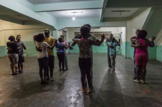 "Dance classes held at night in a parking compound in ""Favela"" Vila do Metrô community, Mangueira, Rio de Janeiro, Brazil."