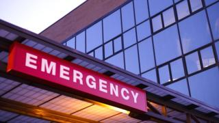 An emergency department sign outside a hospital