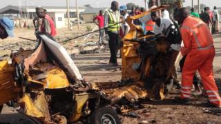 Remains of vehicle after suicide bombings in Maiduguri