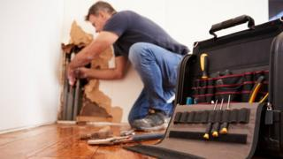 Man making repairs in home