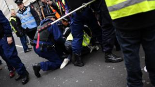 Pro-Brexit 'yellow vest' activists clash with police on Haymarket in London