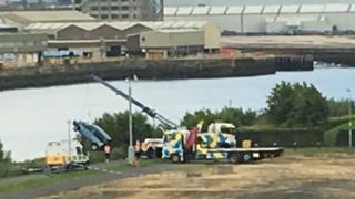 Car being lifted out of the water