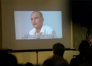 In this photograph taken on March 29, 2016, Pakistani journalists watch a video showing Indian national Kulbhushan Yadav, arrested on suspicion of spying, during a press conference in Islamabad