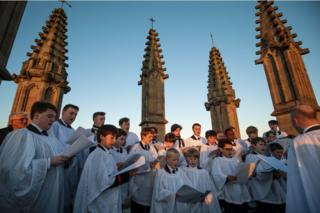 The Magdalen College Choir sing the Hymnus Eucharisticus from the top of the Great Tower, Magdalen College, Oxford