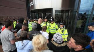 Protesters trying to storm the Alder Hey hospital entrance