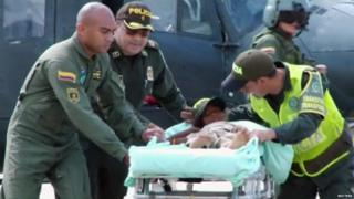 Rescuers take the girl from a helicopter to an ambulance