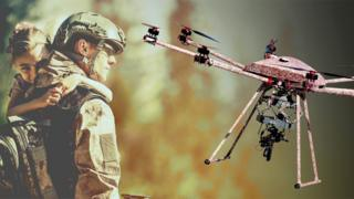 A drone armed with a machine gun next to a soldier holding a child