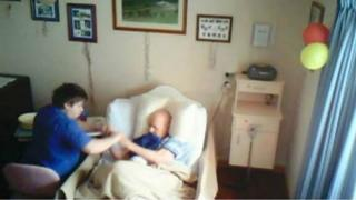 In secretly captured footage, aged care worker Corey Lyle Lucas grabs the arms 89-year-old resident Clarence Hausler