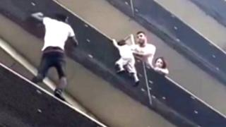Mamoudou Gassama scales building to rescue child. 27 May 2018