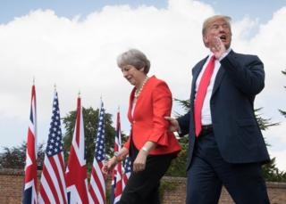 US President Donald Trump walks with Prime Minister Theresa May