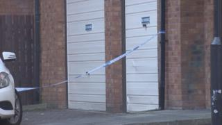 Police tape in Adam Smith Court