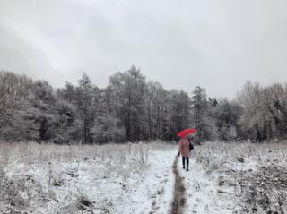A woman walking in the snow near Oxford