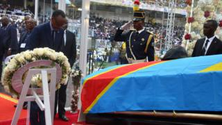 Rwanda's President Paul Kagame pays his respects