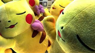Two large pikachu stuffed toys