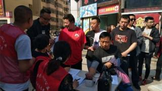 Locals give blood in Yulin city in China where nine schoolchildren were stabbed to death, 28 April 2018