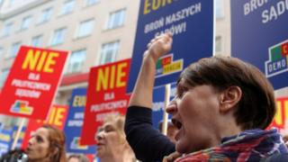 Protesters in Warsaw join a demonstration on 26 June against the Polish government's judicial reforms