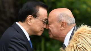 China's Premier Li Keqiang (L) is welcomed to Government House by a Maori elder during a welcome ceremony in Wellington on March 27, 2017.