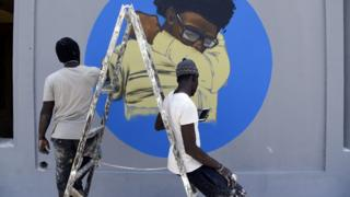 Members of the Senegalese graffiti collective RBS Crew painting a wall at Cheikh Anta Diop University in Dakar, Senegal - Saturday 21 March 2020