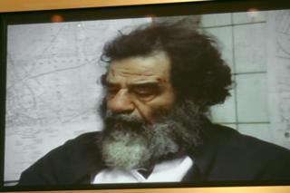 صدام بعد اخراجه من الحفرة