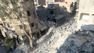 Разбомбленный дом, в котором жила семья Омрана