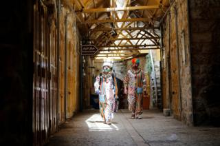 Clowns arrive to entertain Palestinian children in Hebron