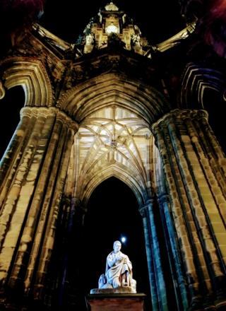 The moon through the Scott Monument in Edinburgh.