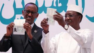 Idriss Deby (R), President of the Republic of Chad, and President of Rwanda Paul Kagame show their e-passports at the opening ceremony 27th ordinary session of the AU Heads of States, Kigali, Rwanda
